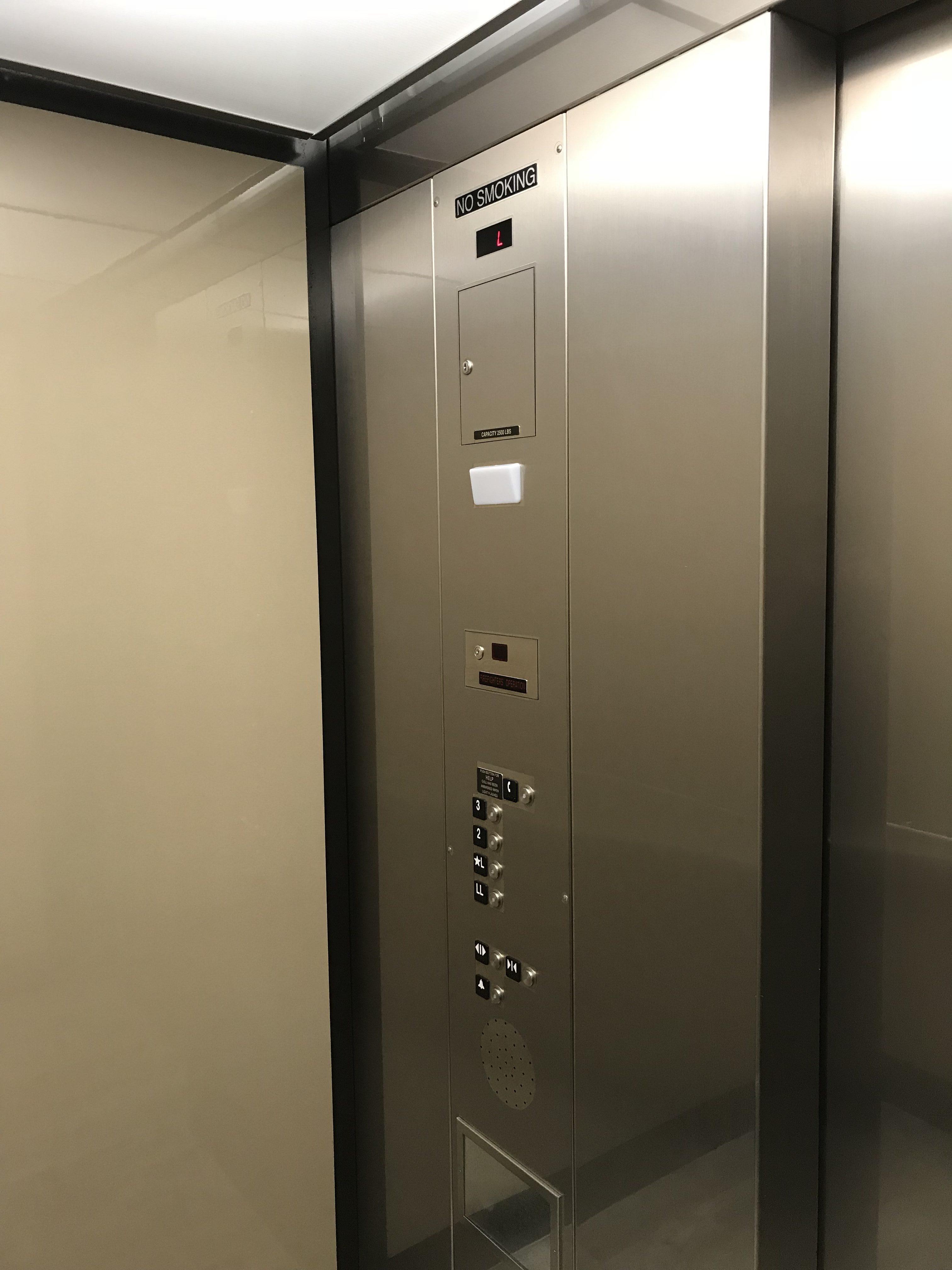 elevator refinishing graffiti shield metal shield colorado film